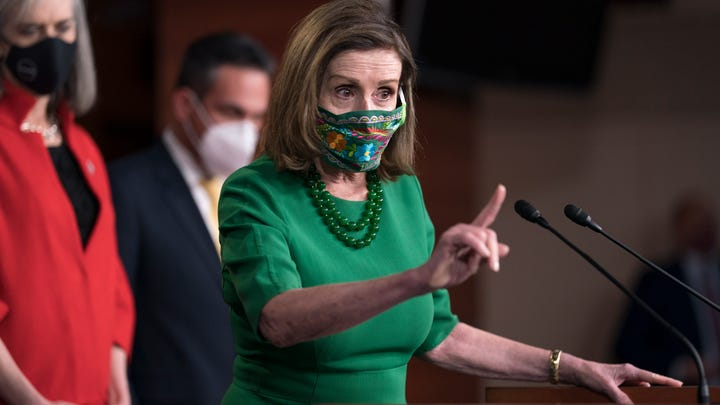 House Speaker Nancy Pelosi, D-Calif., speaks during a news conference Friday in anticipation of the House vote on President Joe Biden's $1.9 trillion COVID-19 stimulus package.