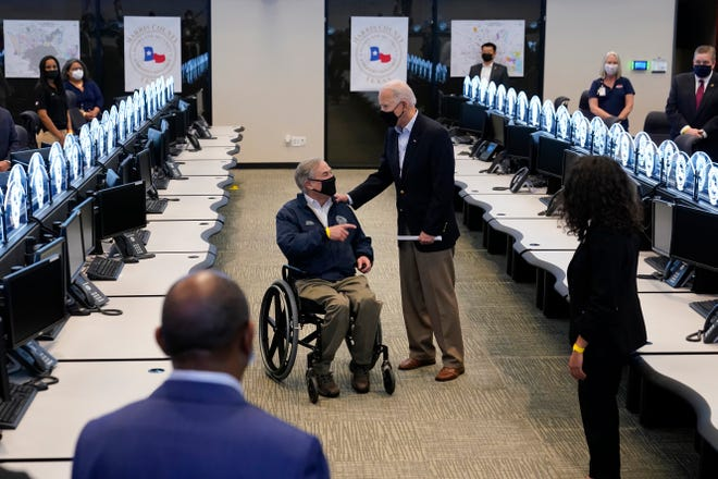 President Joe Biden tours the Harris County Emergency Operations Center with Texas Gov. Greg Abbott, Friday, Feb. 26, 2021, in Houston.