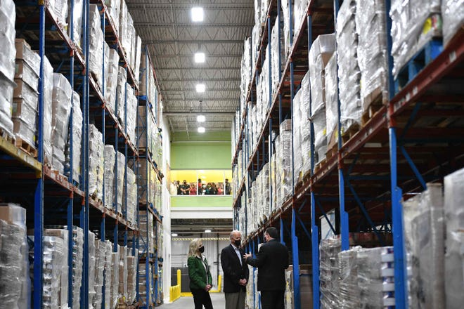 President Joe Biden and first lady Jill Biden with Houston Food Bank CEO Brian Greene, visit the Houston Food Bank in Houston, Texas, on February 26, 2021.