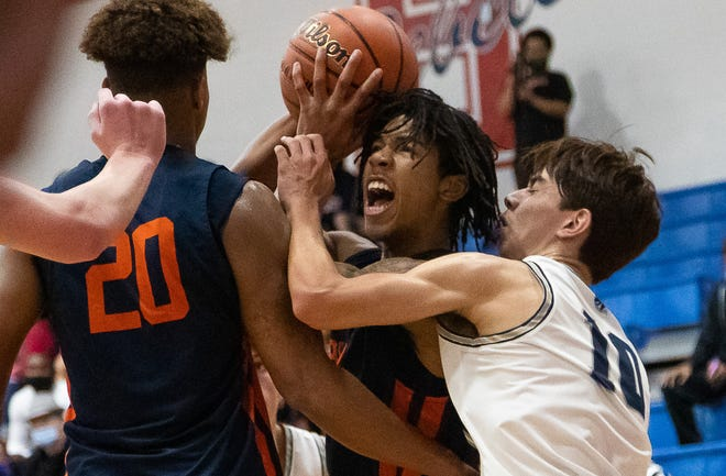 Glenn's Trae Leak draws a blocking foul by a Boerne Champion defender during the second period of the Grizzlies' victory Friday.