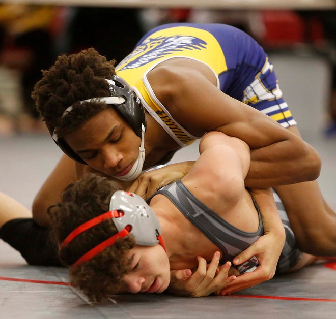 Marlon Yarbrough, top, of Copley, defeats Russell Cash of Canton South in the first round of the 113 weight class during the Division II Sectional Tournament at Northwest High School Saturday, Feb. 27, 2021 in Canal Fulton, Ohio.  Yarbrough went on to win the title.