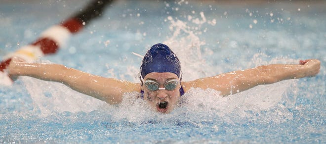 Hudson senior Mackenzie DeWitt swims to a fourth-place finish in the 100-yard butterfly Friday at the Division I state swimming and diving meet at C.T. Branin Natatorium. DeWitt capped here career by reaching the podium in four events and leading the Explorers to a fifth-place finish as a team. [Mike Cardew/Beacon Journal]