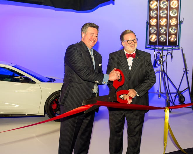 Amarillo College President Russell Lowery-Hart (right) participates in the ribbon cutting with Sharpened Iron Studios Chief Executive Officer Sean Doherty (left) at the company's new downtown location. The studio will also be home to the Amarillo College School of Cinematic Arts.