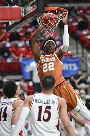 Texas' Kai Jones dunks against Texas Tech during the Longhorns' 68-59 loss in Lubbock on Feb. 27. Jones was named the Big 12's sixth man of the year by the league's coaches.