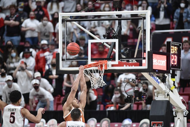 Texas' Jericho Sims misses a dunk while being fouled in the second half of Saturday's loss at Texas Tech. Sims was effective but had only five field-goal attempts in the 68-59 defeat.