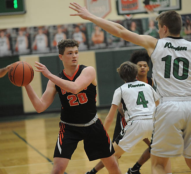 Marlington's Sam Dine looks to pass in an OHSAA tournament game against West Branch Friday, February 26, 2021 at the West Branch Field House.