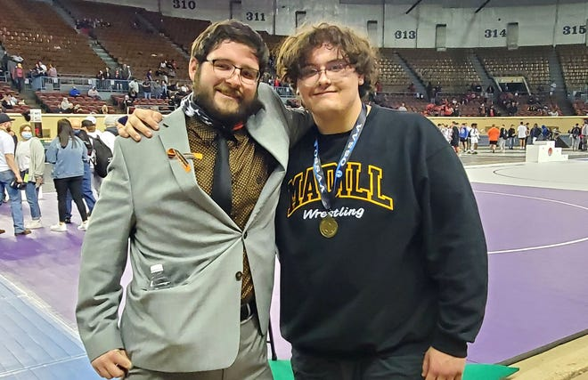 Madill senior Griffon Williams, right, is shown with coach Austin Pettigrew after placing third at the 5A State Wrestling Championship in Oklahoma City.