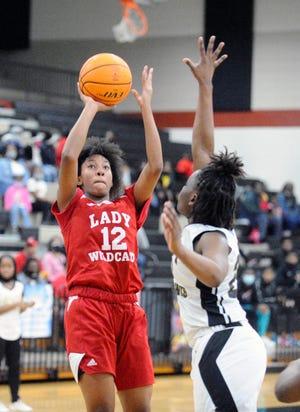 Kiara Turner (12) shoots over a Washington County defender during a Georgia High School Playoff game on Friday, Feb. 26, 2021 in Sandersville, Ga. [WYNSTON WILCOX/THE AUGUSTA CHRONICLE]