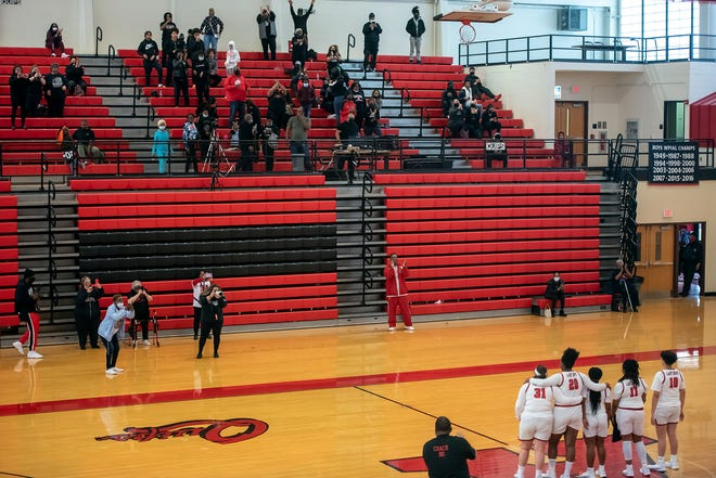 Playoffs during COVID: Seniors on the Aliquippa girls basketball team pose for photos after their WPIAL playoff win over Springdale Saturday at Aliquippa High School. Parents were required to sit in the balcony due to pandemic restrictions.