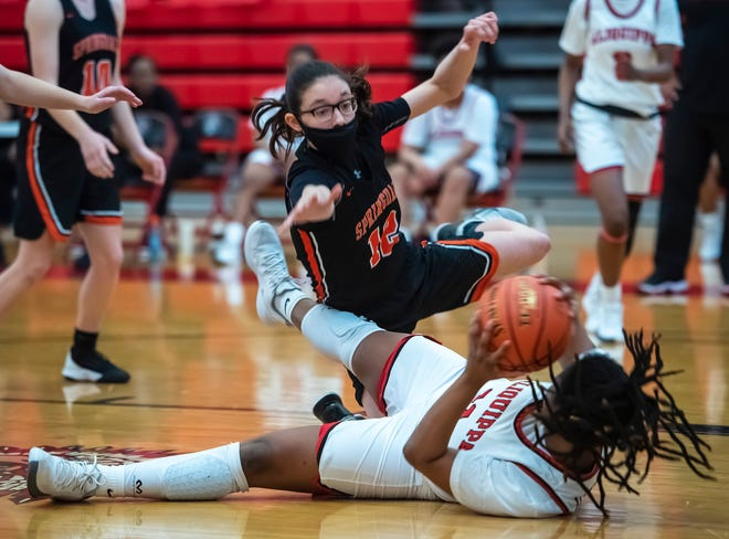 Aliquippa's Ghourni Hannon hits the court as she keeps the ball away from Springdale's Katerina Puskar during their WPIAL playoff game Saturday at Aliquippa High School.