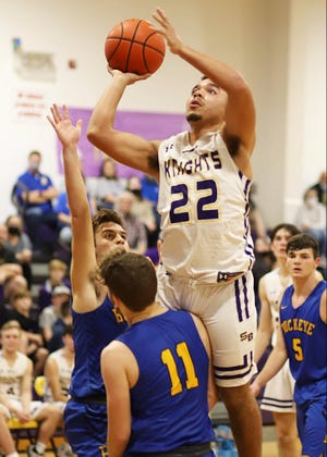 South Beauregard's Malachi McElhaney (22) goes up for two during the Golden Knights' win over Buckeye on Friday.