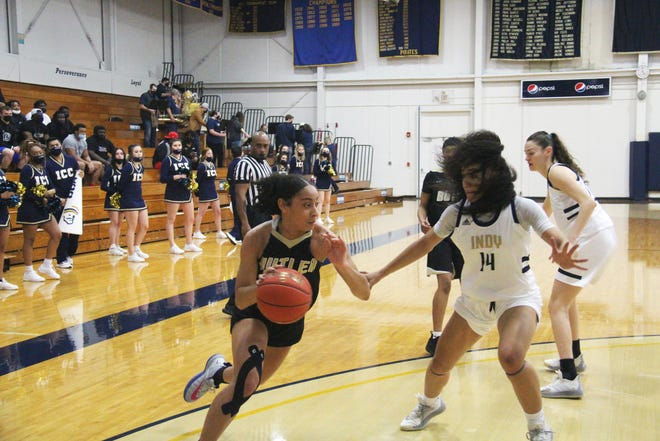 Butler's Skyla Knight (1) drives by Independence CC's Delani Harris (14) in the first half in Saturday's game at Independence CC. Knight scored 18 points as Butler won 68-46.