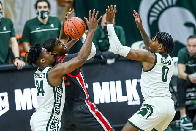 """Help, officer, I want to report a mugging!"" Some readers believed Michigan State took its physical game too far on Thursday against E.J. Liddell and Ohio State."
