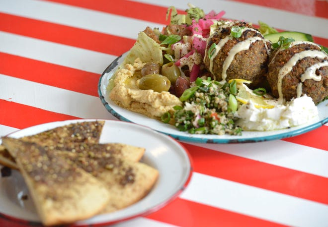 Last week's Lebanese dinner for midweek International Nights from The Canteen restaurant in Provincetown included ground lamb and beef Kebbeh (balls) with fattoush salad. It included a side of labneh, manakish (seasoned flat bread), hummus and olives.