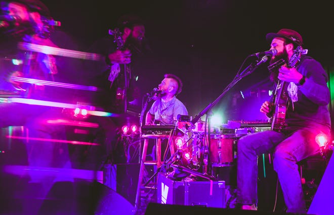 MK Ultra band members Ben Miller, left, and Pat Kay, right, perform Friday night during The Blue Note's first live show since November, when the COVID-19 pandemic forced the venue to temporarily close its doors.