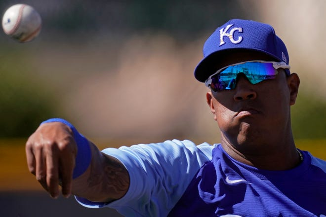Kansas City Royals catcher Salvador Perez throws during spring training practice Wednesday in Surprise, Ariz.