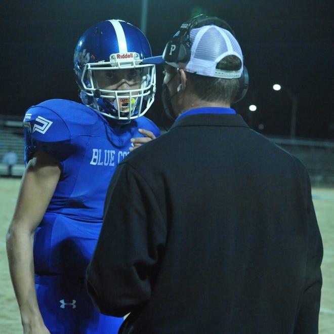 Asheboro coach Blake Brewer talks with Blue Comets quarterback Khyland Hadley-Lindsay. [Mike Duprez/Courier-Tribune]