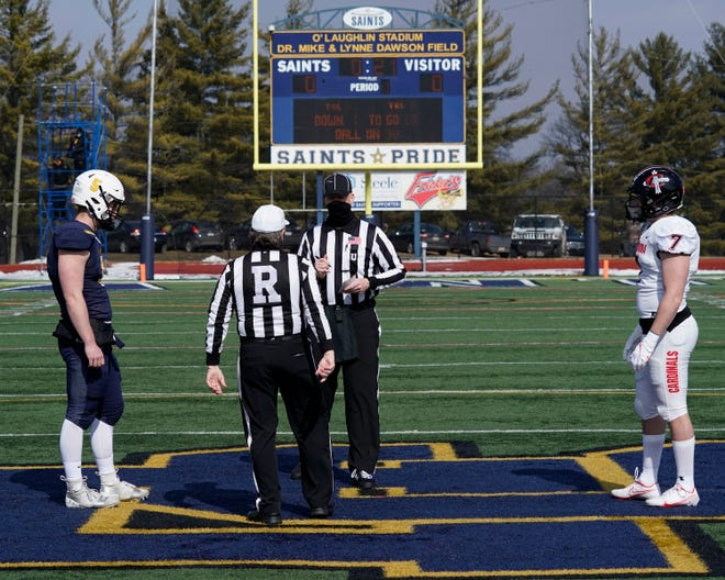 Siena Heights' Tyler Knecht and Concordia's Alex Hinojosa stand at midfield for the pregame coin toss.