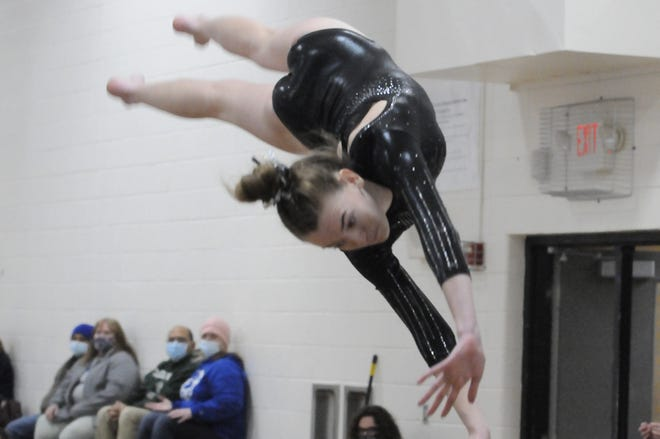 Tecumseh's Jordyn Wright competes in the vault event during Friday's dual meet against Adrian.