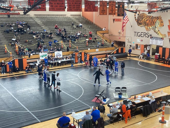 The finalists for Saturday's Northwest Region Class 2A wrestling tournament are introduced during the parade of champions at Sharon. The top three wrestlers in each weight class advanced to a special West super region tournament on March 6 at Indiana, Pennsylvania.