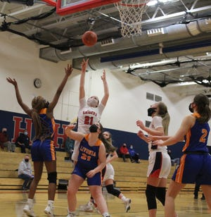 Hornell's Maddie Moore (21) grabs the rebound and puts it back up for two points during Friday's win over Livonia in Hornell.