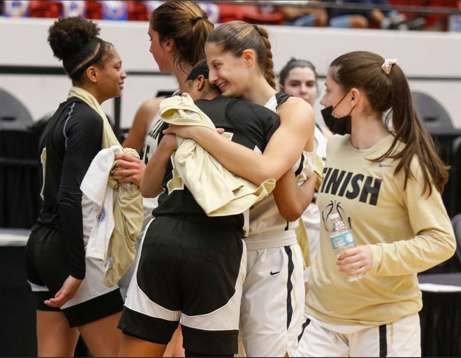 Oakleaf players are consoled by Tampa Plant teammates at the end of the game. [Calvin Knight/Special to the Lakeland Ledger]