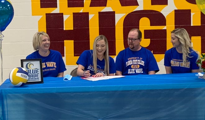 Hays High senior Brooklyn Schaffer, accompanied by her family, signs her letter of intent to play volleyball at Florida State College at Jacksonville on Friday at Hays High.
