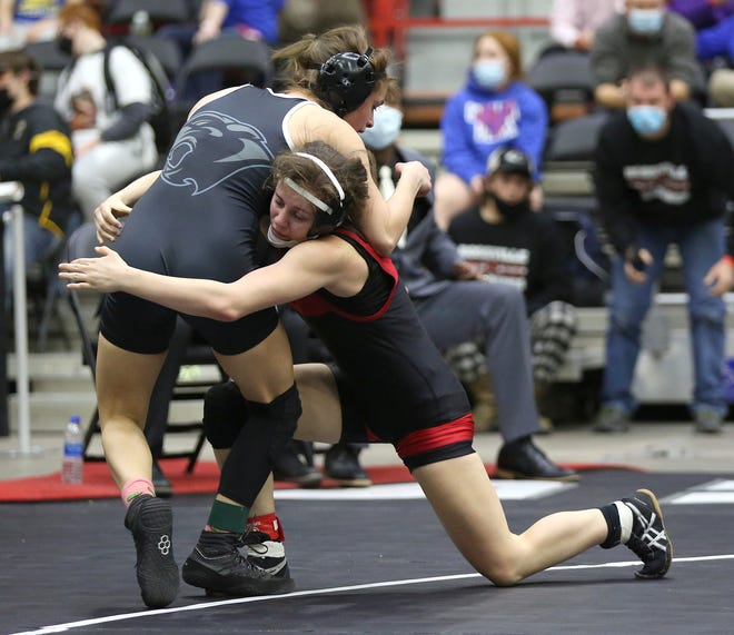 Rossville's Kendra Hurla wrestles Paola's Kailyn Younger in the 120-pound weight class championship of the girls Division II state wrestling tournament on Friday, Feb. 26, at the Tony's Pizza Events Center in Salina. Hurla defeated Younger by fall.