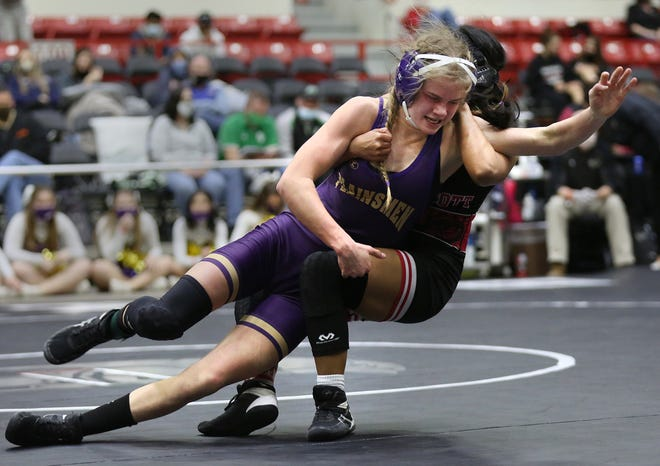 Oakley's Citori Bosserman wrestles Fort Scott's Nicole Montojo in the 101 pound weight class championship of the KSHSAA Girls Div II State Wrestling Tournament at the Tony's Pizza Events Center in Salina Friday, Feb. 26, 2021. Bosserman defeated Montojo by 5-3 decision.