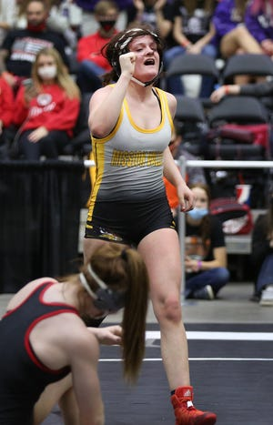 Eskridge-Mission Valley's Hope Blake celebrates her 2-1 decision win over Marysville's Elise Rose in the 132 pound weight class championship of the KSHSAA Girls Div II State Wrestling Tournament at the Tony's Pizza Events Center in Salina Friday, Feb. 26, 2021.