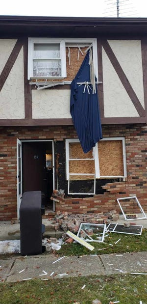An explosion at a Canal Fulton apartment complex caused extensive damage to the three-unit building.