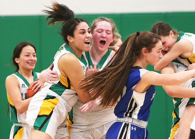 Milan's Cady Pauley, right, and Jordyn Gray react Saturday afternoon at Milan High School during the Class 3 District 16 Girls Basketball Championship.