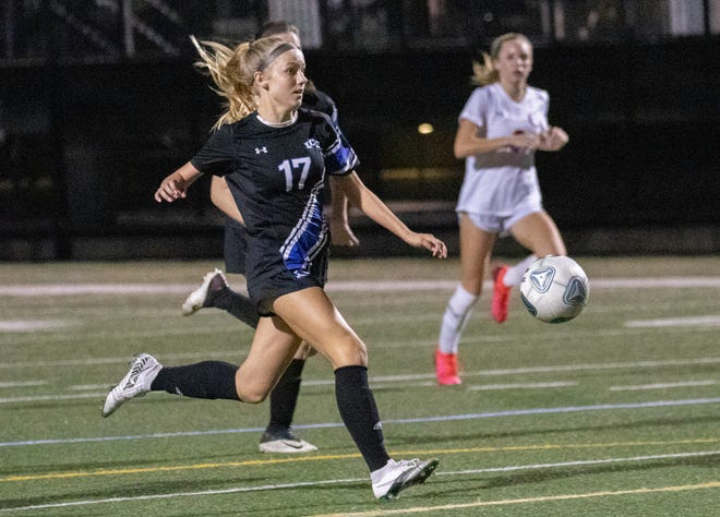 Lakeland Christian's Carly Sabat races toward the goal en route to scoring her second goal of the game against Bolles on Friday night in the Class 2A girls soccer state semifinals at Viking Stadium.