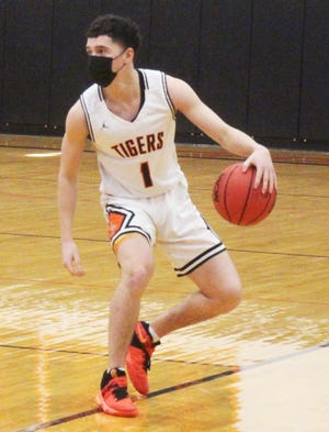 La Junta High School's Thomas Garcia dribbles the ball in Saturday's game with Salida at Tiger Gym. Garcia scored 13 points against Ellicott on Friday and 10 against Salida.