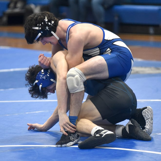 Logan Sander of Dundee works over Joe Haynes of  Warren Woods Tower leading the 125 pound match 3-1 before it was called due to an injury Saturday. Sander is ranked 13th in Division 3 and Haynes is ranked No. 1 in Division 2.