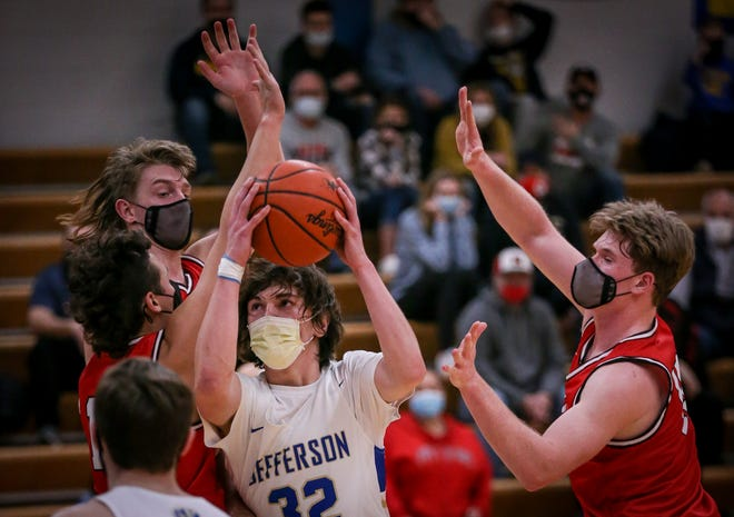 Jefferson's Jackson Barath (center) goes up for a shot between New Boston Huron defenders Rory Callahan, Chase Molnar and Frank Marvaso earlier this season.