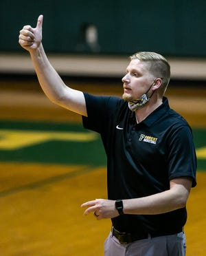 Forest High School boys basketball head coach Spencer Ashley signals his players during the Class 6A Boys Basketball Regional Finals against  Tallahassee Lincoln on Feb. 26 in Ocala. Ashley resigned on Friday morning.