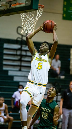 Forest's Brenen Lorient dunks the ball in the final period as the Wildcats defeated Tallahassee Lincoln, 50-47, last Friday to advance to the Class 6A state semifinals against Bartow in Lakeland.