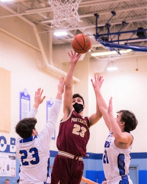 Portsmouth's Connor Hepponstall gets off a shot over Oyster River's Trevor Borges (23) and Riley Beauchesne (21) during Thursday's boys basketball game in Durham. Portsmouth ended its regular season on Friday with a 59-39 win over Dover.