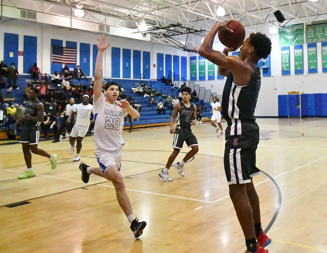 Dwyer's Xavier Scott Jr. attempts three-point shot from the corner during the second half of Friday's 70-54 regional finals win against Coral Springs. He finished with 10 points in the contest.