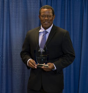 Habtu Afework Belayneh of Boynton Beach, director of tennis at Tivoli Lakes, was named Humanitarian of the Year by the Professional Tennis Registry. The presentation was made at the organization s International Tennis Symposium on Hilton Head Island, S.C. (Contributed by SmartyPantsPhotography)
