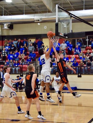 The Blizzards' Trent Hamilton (22), puts the ball in the basket on a layup over the Wink defender. Hamilton's size, skill and athleticism were tough for the Wink Wildcats to defend in the 2A state quarterfinal game.