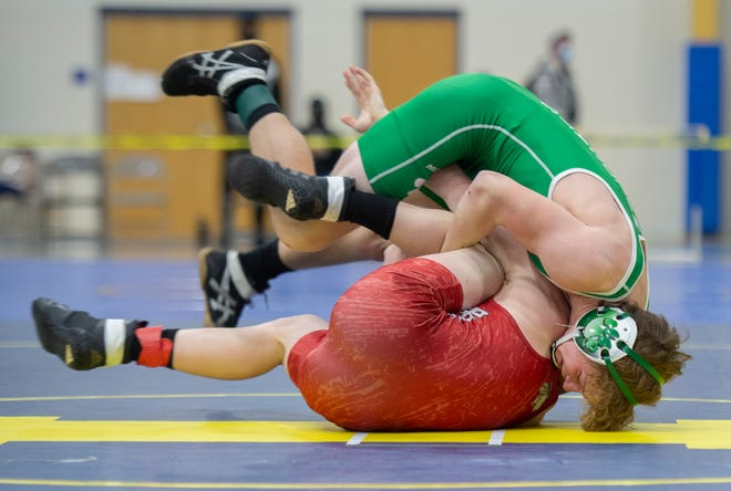 Jonathan Karasek (green) of Mogadore pins Dustin Kattler of Cuyahoga Heights in the semifinals of the 132-pound weight class at the Division III sectional wrestling tournament at Independence on Saturday.