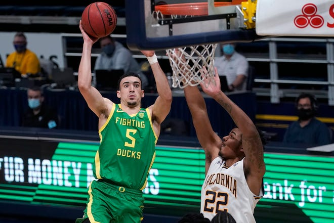 Oregon guard Chris Duarte (5), here shooting against California forward Andre Kelly (22),  was named a third-team All-American by the Associated Press on Tuesday.