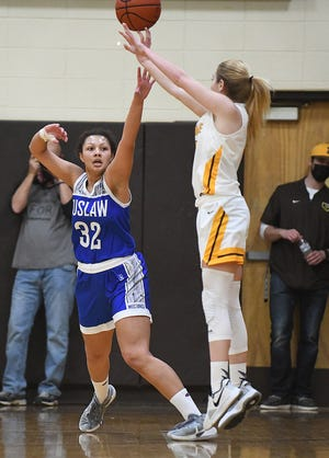 Kelsey Wolfe of Waynedale puts up a two point attempt over Brook Stookey of Tuslaw in the second half at Waynedale High School in this district championship game.