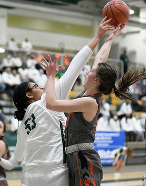 GlenOak's Jordan Weir blocks the shot of Green's Mallory Oddo in the second half of last week's Division I district championship game.