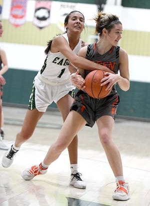 Allyson Marcum of GlenOak tie up a jump ball with Riley Chmielewski of Green in the fourth quarter at GlenOak in the girls Div. 1 District finals Friday, February 26, 2021.