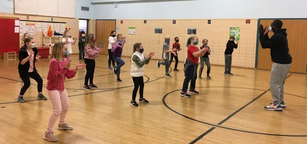 Third grade students perform Steppin' and Stompin' under the direction of their physical education teacher Mr. O.