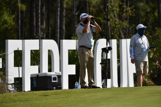 Spotters on the 12th fairway at The Concession Golf Club in Bradenton are on the lookout for balls during third-round play of the Workday Championship Saturday. MIKE LANG/HERALD-TRIBUNE