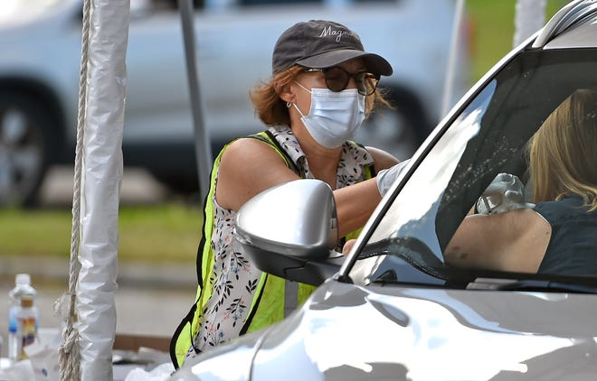 The city of Sarasota hosted a drive-thru, appointment-only COVID-19 vaccination clinic in the parking lot of the Van Wezel Performing Arts Hall in February.